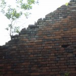 Loose bricks over a means of escape
