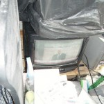 T.V. on surrounded by paper = high fire risk