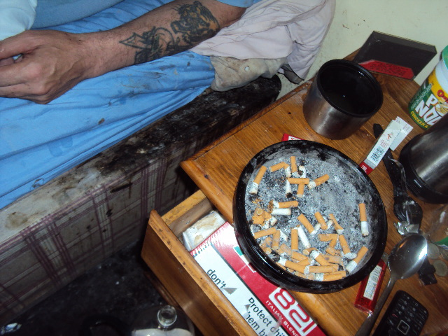 Burn marks on bed, carpet and full ashtray all contributes to serious risk of fire occurring